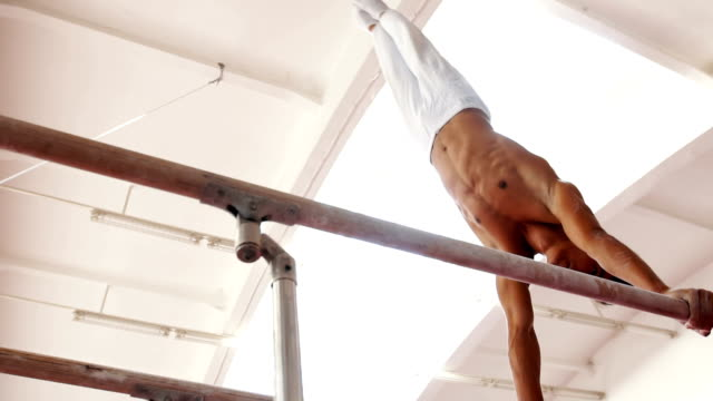 Professional athlete on a parallel bars video