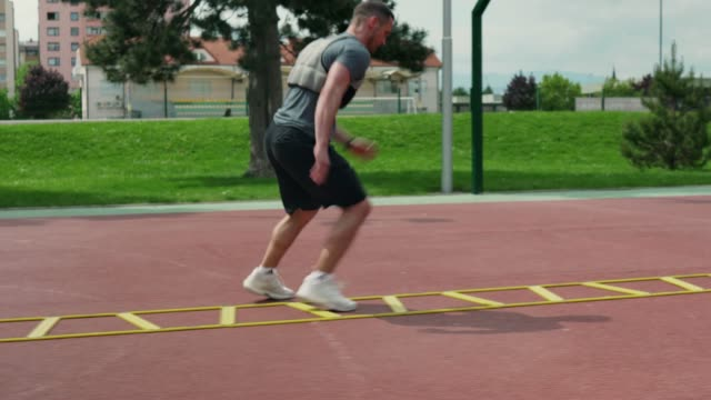Professional athlete training outdoors to improve his performance video