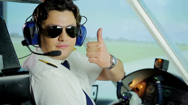 Professional aviator making thumbs up sign for camera, reliable airline services video