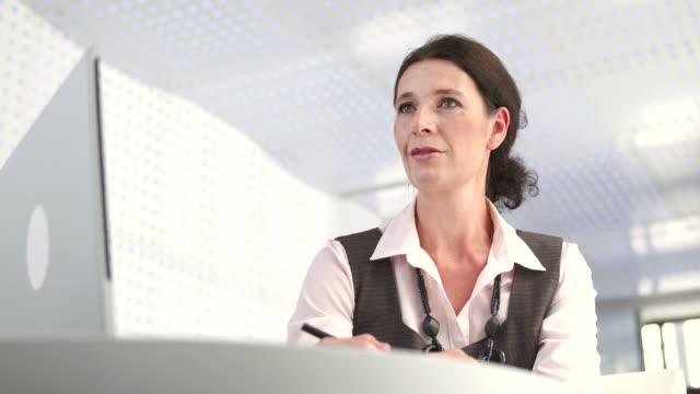 HD: Professional Bank Teller At Work video