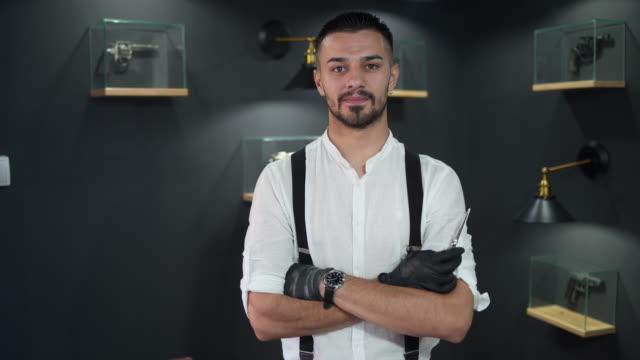 Professional barber at his barber shop