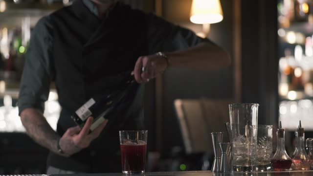 A professional bartender opens a bottle of champagne video