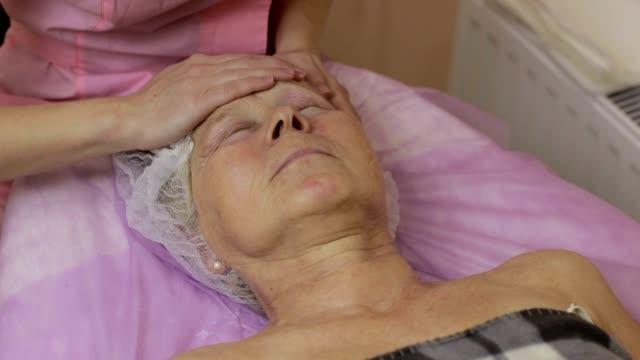 Professional beautician massaging human face video