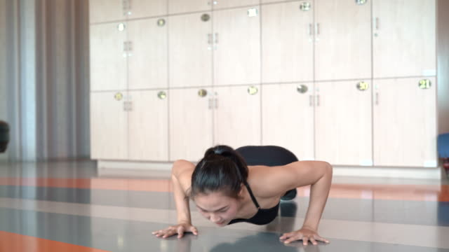 vídeos de stock e filmes b-roll de professional beautiful asian woman workout doing push up exercise in the fitness gym healthy lifestyle, athlete muscle building strong and fit body, slow motion 4k resolution. - gmail