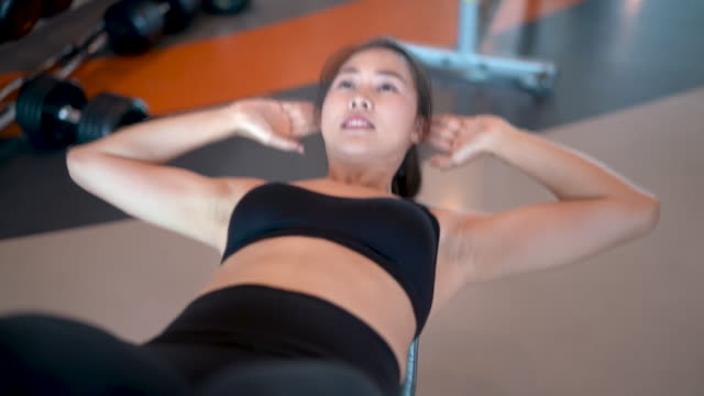 vídeos de stock e filmes b-roll de professional beautiful asian woman workout doing sit up exercise in the fitness gym healthy lifestyle, athlete abs muscle building strong and fit body 4k resolution. - gmail