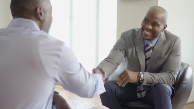Professional Business Advisor Handshake with Customer During a Home Meeting