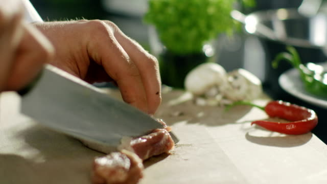Professional Chef Cuts Meat on a Cutting Board. video