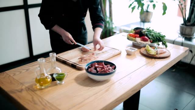 Professional chef preparing meat video