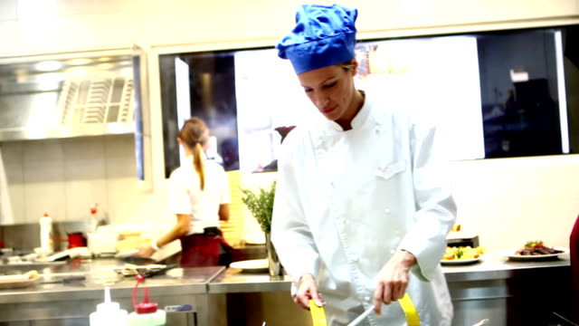 Professional chefs in restaurant kitchen before lunch time. video
