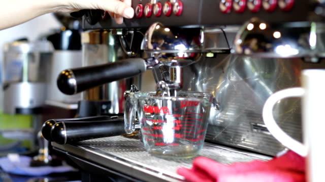 Professional coffee machine making espresso video