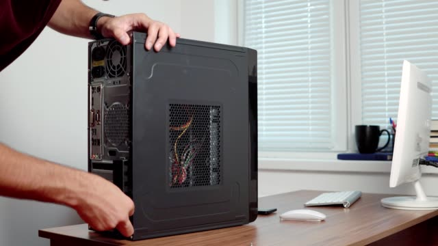 Professional computer repairer man upgrading computer hardware. Shot in 4k video