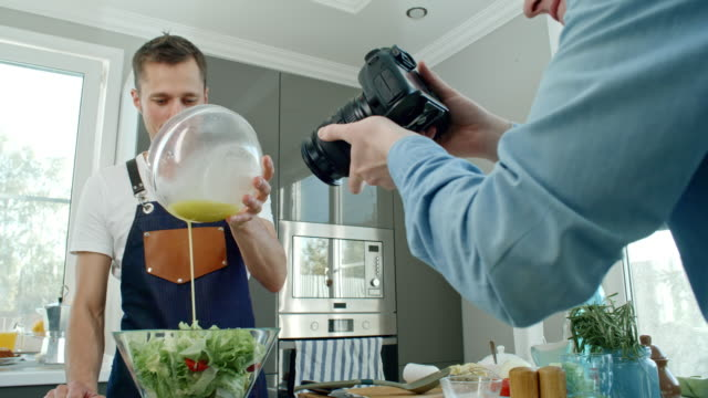Professional Cook Pouring Dressing into Salad video