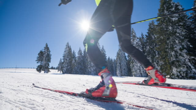 Professional cross country skier skate skiing uphill video