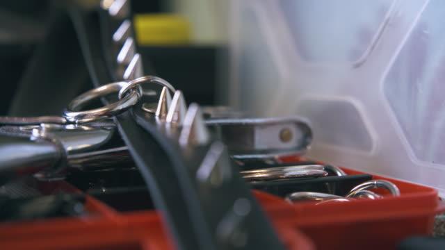 Professional designer puts black leather choker in red box