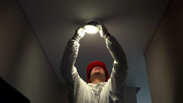 professional electrician man mount circle led light into ceiling hole video