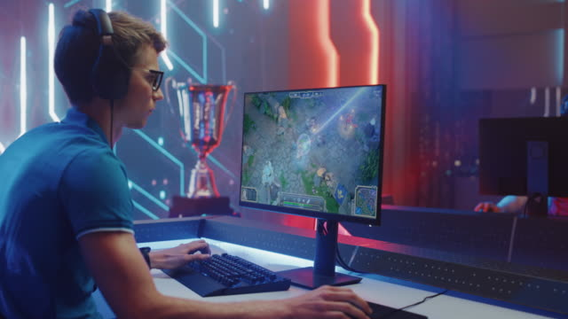Professional eSports Gamer Plays RPG MOBA Mock-up Video Game with Fun Special Effects on Computer at Championship Event. Online Cyber Tournament. Arc View Medium Shot Professional eSports Gamer Plays RPG MOBA Mock-up Video Game with Fun Special Effects on Computer at Championship Event. Online Cyber Tournament. Arc View Medium Shot gamer stock videos & royalty-free footage