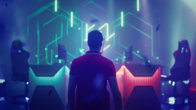 Professional eSports Gamer walking on Stage to Participate in the Cyber Games Championship Event. Competitive Online Live Streaming Tournament. Colorful Stylish Following Back View Shot Professional eSports Gamer walking on Stage to Participate in the Cyber Games Championship Event. Competitive Online Live Streaming Tournament. Colorful Stylish Following Back View Shot gamer stock videos & royalty-free footage