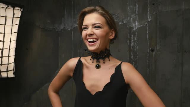 professional fashion model smiling in  the studio. 4K video