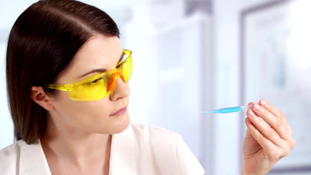 professional female doctor in laboratory with innovative treatment. woman scientist at work - science research stock videos & royalty-free footage