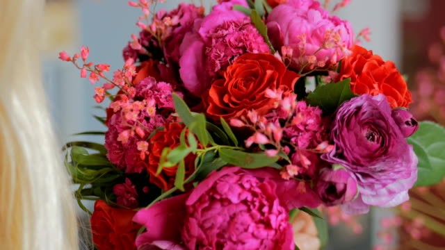 Professional florist making beautiful bouquet at flower store Professional woman floral artist, florist making beautiful wedding bouquet at workshop, flower shop. Close up shot. Floristry, handmade and small business concept bunch stock videos & royalty-free footage