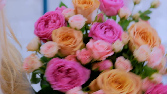 Professional florist making beautiful bouquet at flower store video