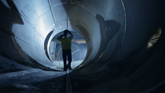 Professional Heavy Industry Welder Working Inside Pipe. Construction of the Oil, Natural Gas and Fuels Transport Pipeline. Industrial Manufacturing Factory