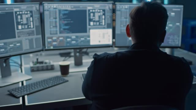 professional it programer working in data center on desktop computer with three displays, doing development of software and hardware. displays show blockchain, data network architecture concept - apprendimento automatico video stock e b–roll