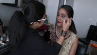 istock Professional make-up artist at work 1211248403