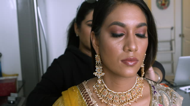 Professional make-up artist at work video