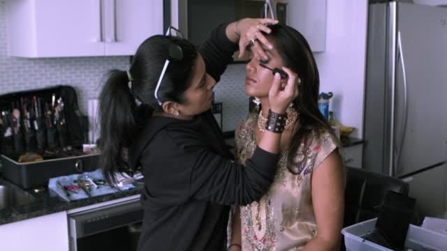 Video Professional make-up artist at work