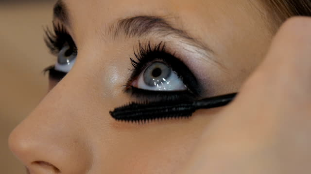 Professional make-up artist, eye color pattern, close-up. video
