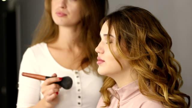 Professional makeup. Powder. Professional make-up artist. video