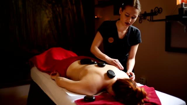 professional massage - terapia lastone filmów i materiałów b-roll