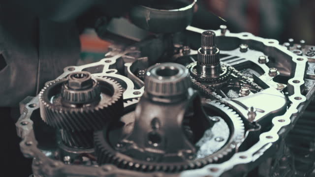 Professional mechanic repairing a continuously variable transmission video