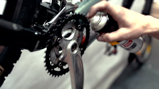 Professional mechanic repairing mountain bike with tool in workshop video