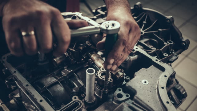 Professional mechanic repairing V10 engine in auto repair shop video