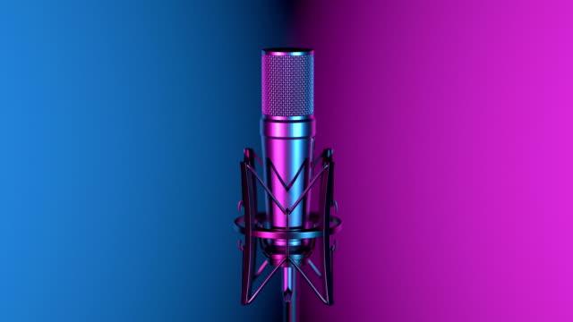 vidéos et rushes de microphone professionnel contre le changement de fond coloré - studio d'enregistrement