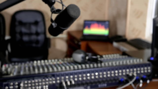 professional microphone in recording studio on background of audio console with headphones video