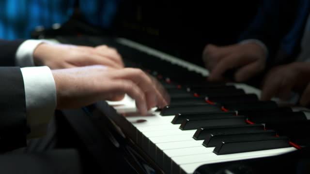 hd: professional pianist playing the piano - piano stok videoları ve detay görüntü çekimi