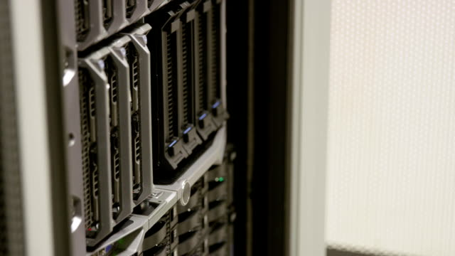 IT professional replace blade server in large datacenter video