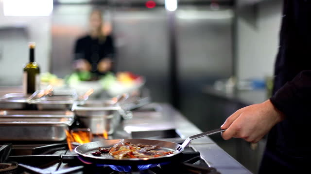 professional restaurant or hotel kitchen two cooks working at professsional restaurant or hotel kitchen commercial kitchen stock videos & royalty-free footage