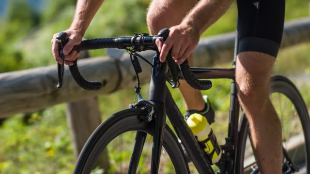 professional road cyclist - ciclismo su strada video stock e b–roll