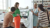 istock Professional showing dress to coworkers in office 1150981590