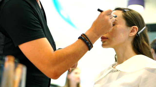 Professional skin care. Beautiful brunette girl slow motion shot video