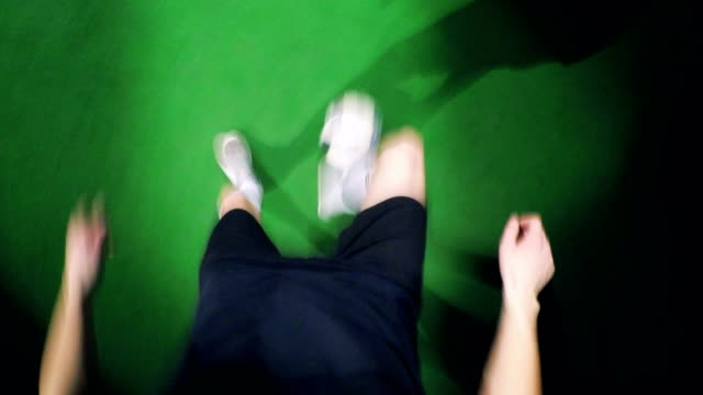 Professional soccer player is dribbling a ball on the floor, view from above, camera on his head. video