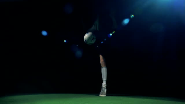 professional soccer player is juggling and making tricks, view from below. - трюк стоковые видео и кадры b-roll
