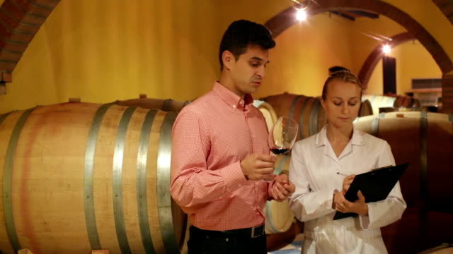 Professional sommelier advising male custome video