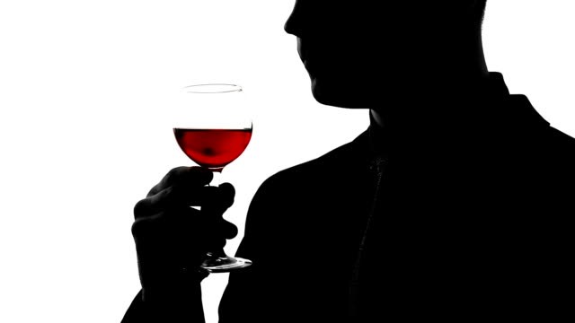 Professional sommelier tasting expensive alcoholic beverage, man drinking cognac video