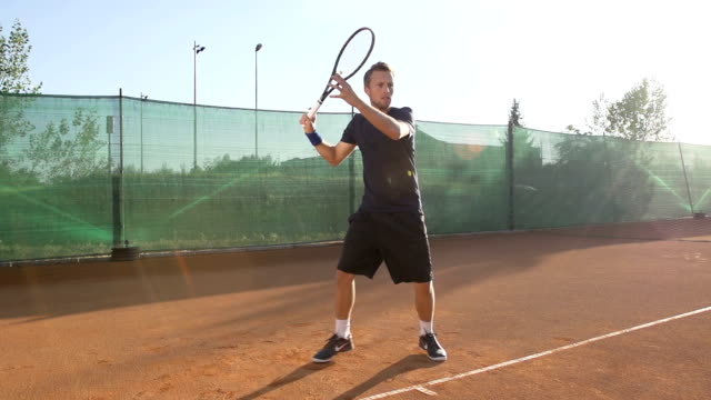 Professional Tennis Player Hitting The Ball With Racket video