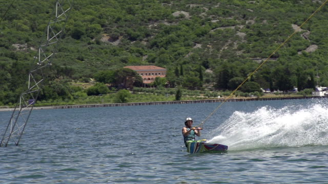 SLOW  MOTION: Professional wakeboarder jumps high video